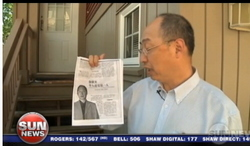 BC Conservative candidate Lawrence Chen holds copy of Frank Huang 2012 article in the Chi-Com's People's Daily paper.
