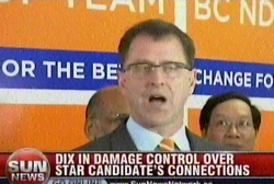 Chinese Communist Party-linked NDP candidate Frank Huang stands behind Socialist NDP leader Adrian Dix, who stands behind Huang.